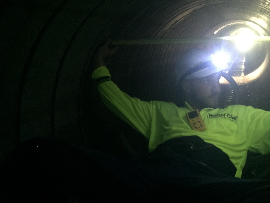 A Wilmot Plumber Going Down into a Confined Space